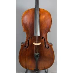 Gammal cello med reparationsetikett Amkoff 1985